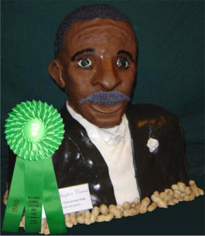 Bust of George Washington Carver carved out of cake and decorated with fondant icing